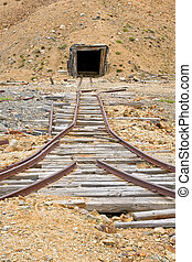 Mining rail and shaft - Old rail tracks leading to an...
