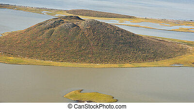 Pingo Formation - Pingos are mounds of earth-covered ice...
