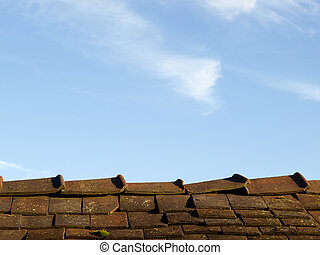 An Old Leaky Roof against Blue Sky - A roof with cracked...