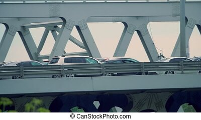Rush hour traffic on a city car bridge. Telephoto lens pan...