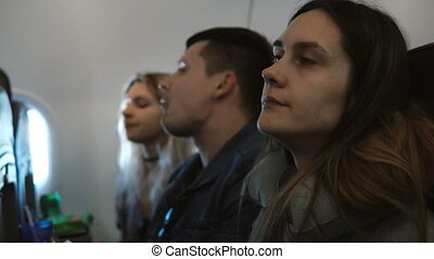 Young group of people traveling by plane together. Portrait...