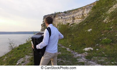 Two musicians Pianist and accordionist playing on the rocks...