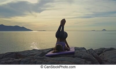 Drone View Girl Does Yoga against Pictorial Golden Sunrise -...