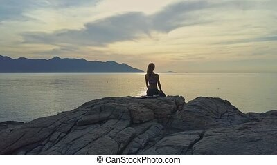 Girl with Pigtail Stands to Yoga Pose Bridge at Sunrise -...