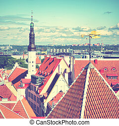 Cityscape of Tallin with with city halls tower and rooster...