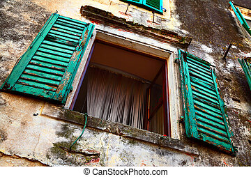 Wide open window of old house