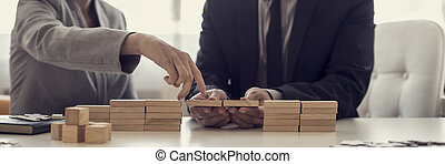 Retro image of businesspeople solving problems by building...
