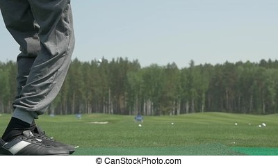 pro golf player shot ball from sand bunker at course. Section of man playing golf in golf course. Golfers hit sweeping golf course in the summer