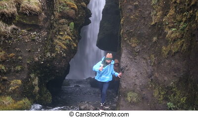 Two young tourists exploring the powerful waterfall...