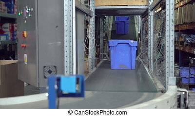 Packaging lines with plastic blue boxes - Boxes moving on...