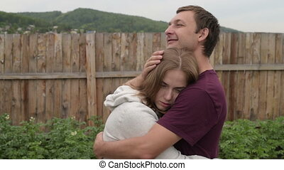 Man consoling his girlfriend, she is sad and he is calming...