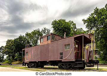 Old rusted caboose - An old weathered train caboose