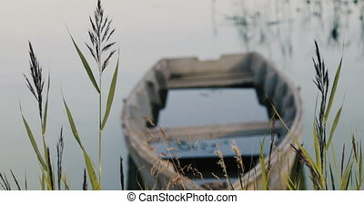 Old boat on shore of lake