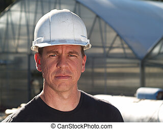 Man in Hard Hat - Rugged looking man wearing a hard hat