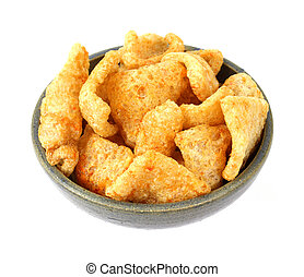 Barbeque seasoned pork rinds in an old bowl - Several...