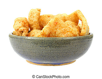 Bowl full of barbeque seasoned pork rinds - An old stoneware...
