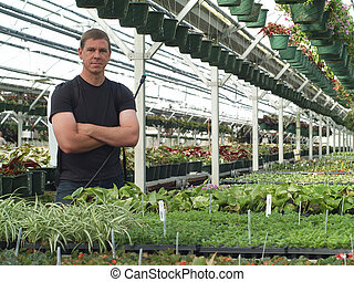 Green House Boss - Confident looking man in commercial green...