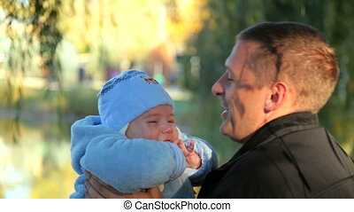 happy father and baby - happy father is holding the baby