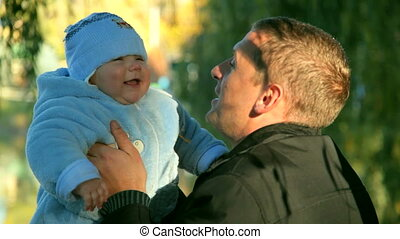 father and baby laugh