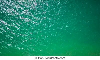 Aerial survey from a drone over the surface of the ocean