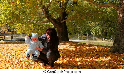 young mother with baby - young mother and baby in the park