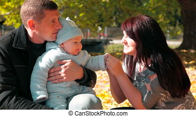 Family - Happy Family Holding Their Child
