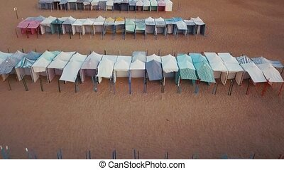 Flying over the beach awnings on the Atlantic coast