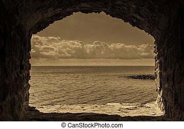 Seascape in stone window casing frame.