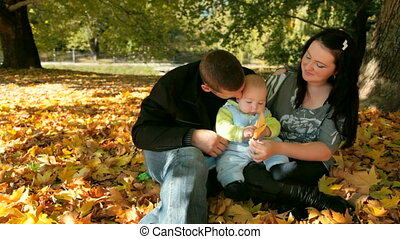 Family with Child - Happy Family Holding Their Child