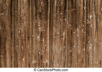 Wooden background with lots of stapler pins in it