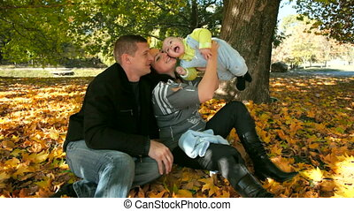 happy Family with Child - Happy Family Holding Their Child...