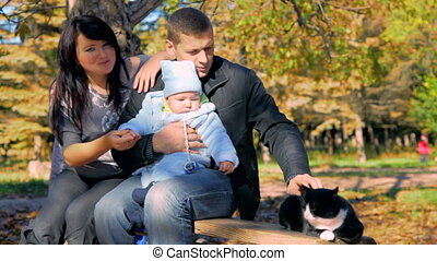 Happy family with cat - Happy family with pet resting...