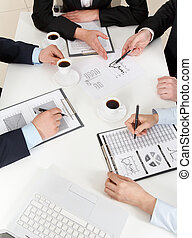 Consultation - Above view of friendly workteam working with...