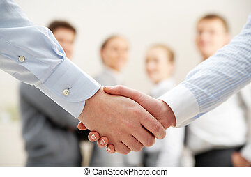 Symbol of partnership - Image of business handshake after...
