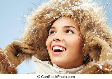 Girl in hood - Happy woman with furry hood on head in good...