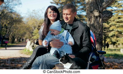 family and cat - happy family with a toddler and a pet...