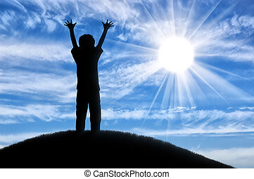 Happy childhood concept. Silhouette of a happy child on the...
