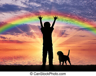 Happy childhood concept. Silhouette of a happy child and dog...
