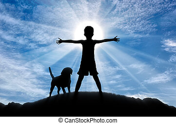 Happy childhood concept. Silhouette of a happy child on top...