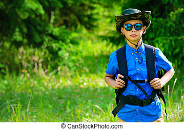 boy scout in a forest - Ten year old boy go hiking with...