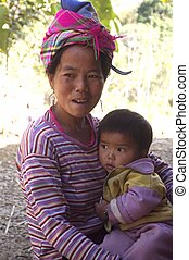 Motherly Love	 - A Hmong flowered woman and baby