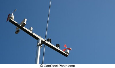 The anemometer in the sun's rays measures the wind speed.