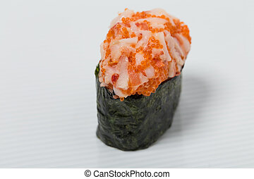 Gunkan sushi with snow crab. Can be used as a background.
