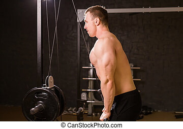 man with weight training in gym equipment sport club fitness and bodybuilding