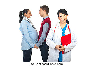Family doctor and pregnant couple - Smiling family doctor in...
