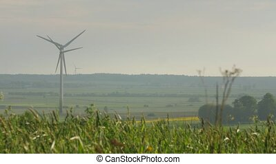 wind turbines isolated on overcast sky background - few wind...