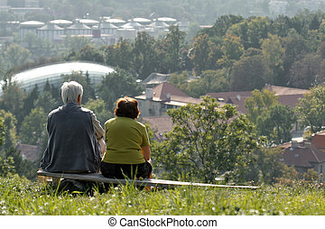 two old people on bench