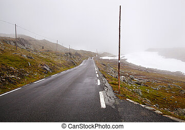 national tourist road 55 Sognefjellsvegen in misty weather,...