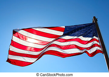 american flag backlit from the sun