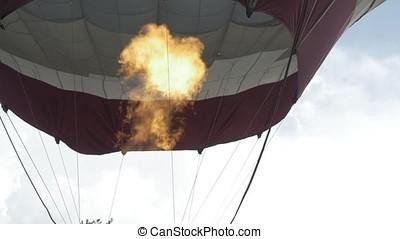 Close up of hot air balloon burner flame glowing. Hot air balloon in flight in the sky close up